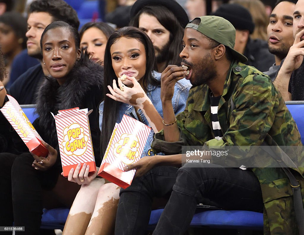 Winnie Harlow (C) attends the Denver Nuggets v Indiana Pacers match as part of the NBA Global Games London 2017 at The O2 Arena on January 12, 2017 in London, England.