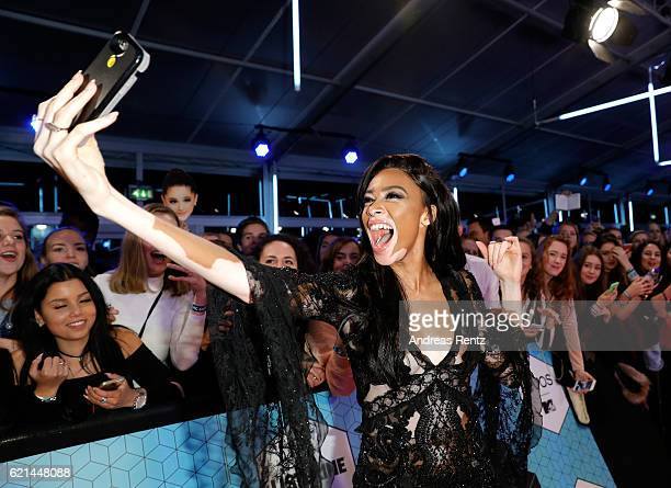 Winnie Harlow poses for selfies with fans as she attends the MTV Europe Music Awards 2016 on November 6 2016 in Rotterdam Netherlands