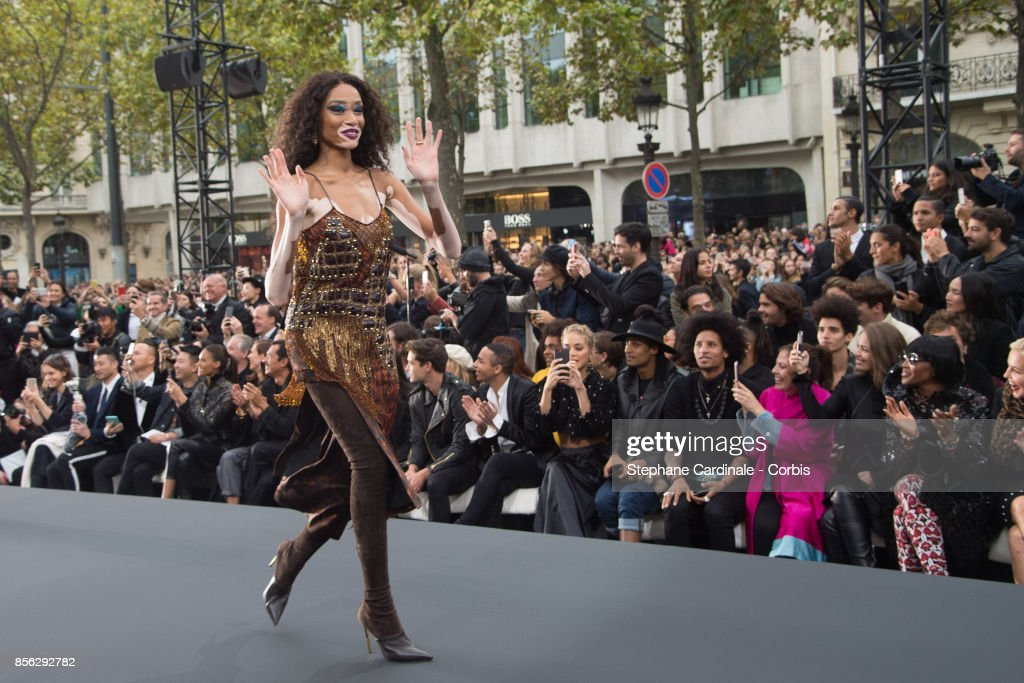 Winnie Harlow walks the runway during the Le Defile L'Oreal Paris Spring Summer 2018 show as part of Paris Fashion Week at Avenue des Champs-Elysees on October 1, 2017 in Paris, France.