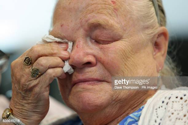 Winnie Johnson mother of murder victim Keith Bennett wipes her eyes as she watches footage of the moors where the body of her son is believed to be...