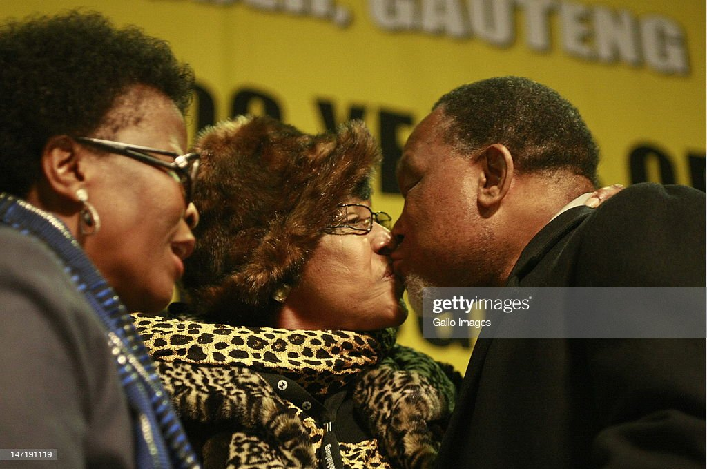 Winnie Madikizela- Mandela embraces the Deputy President Kgalema Motlanthe at tthe opening of the ANC's four-day policy conference held at Gallagher Estate on June 26, 2012 in Johannesburg, South Africa. The conference is in preparation for the ANC's national elective conference to be held in Mangaung in December.