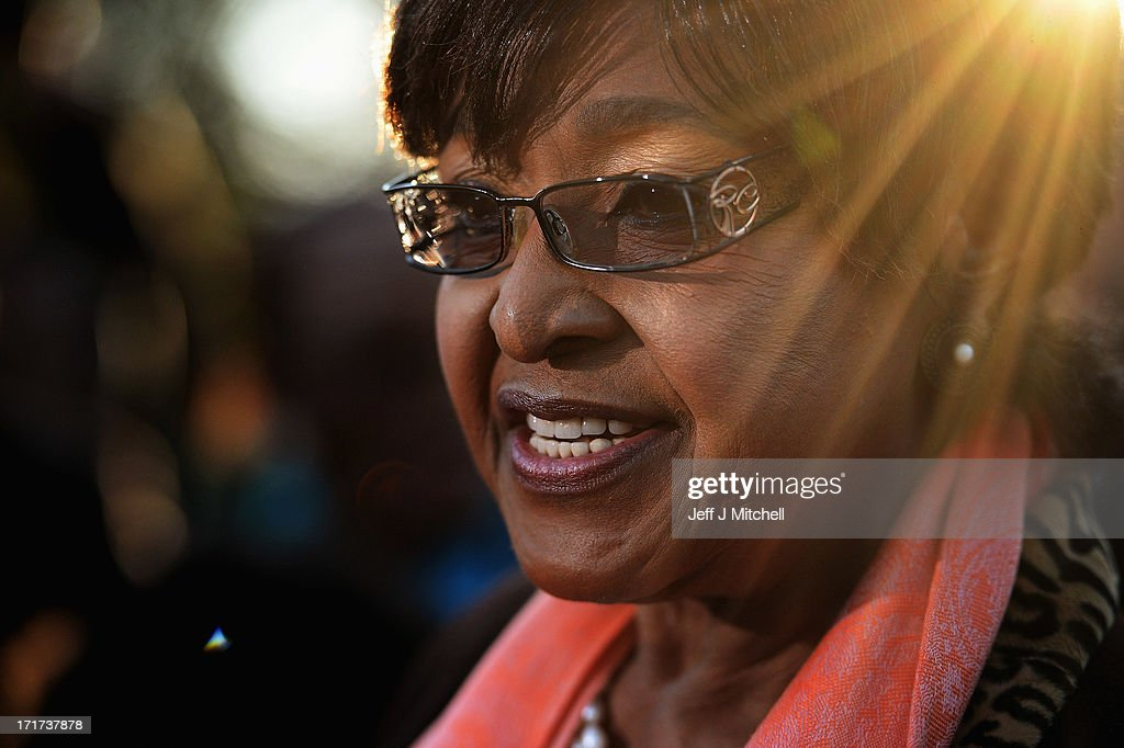 Winnie Madikizela Mandela former wife of Nelson Mandela makes a statement to the media outside their first family home in the Soweto Township on June...