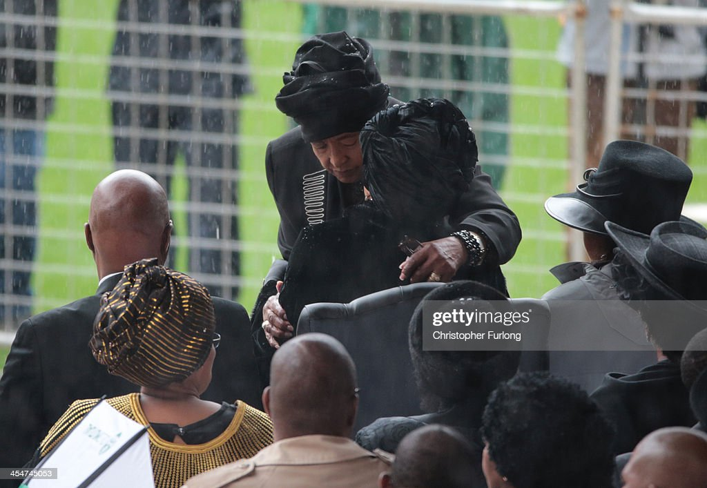 Winnie Madikizela-Mandela (L) and Graca Machel embrace as they arrive for the official memorial service for former South African President Nelson Mandela at the FNB Stadium on December 10, 2013 in Johannesburg, South Africa. Over 60 heads of state have travelled to South Africa to attend a week of events commemorating the life of former South African President Nelson Mandela. Mr Mandela passed away on the evening of December 5, 2013 at his home in Houghton at the age of 95. Mandela became South Africa's first black president in 1994 after spending 27 years in jail for his activism against apartheid in a racially-divided South Africa.