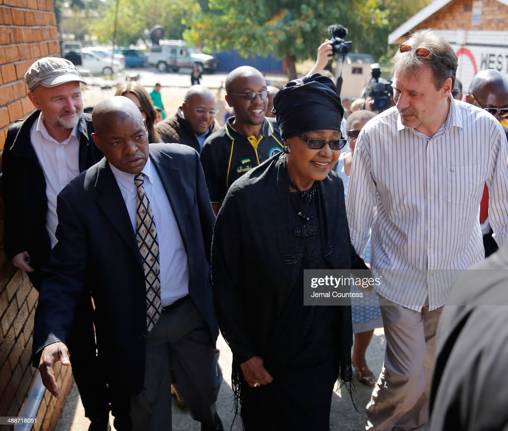 Winnie MadikizelaMandela arrives at the Orlando West Voting Station at the Orlando West Secondary School during the 2014 South African General...