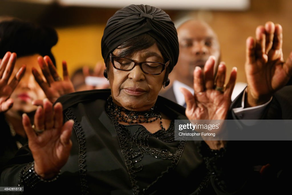 Winnie Madikizela-Mandela, ex-wife of former South Africa President Nelson Mandela prays as she attends a service at Bryanston Methodist Church during a national day of prayer, on December 8, 2013 in Johannesburg, South Africa. Mandela, also known as Madiba, passed away on the evening of December 5th, 2013 at his home in Houghton at the age of 95. Mandela became South Africa's first black president in 1994 after spending 27 years in jail for his activism against apartheid in a racially-divided South Africa