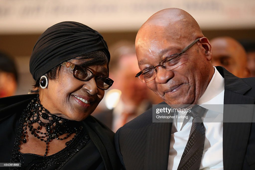 Winnie Madikizela-Mandela, ex-wife of former South Africa President Nelson Mandela and President <a gi-track='captionPersonalityLinkClicked' href=/galleries/search?phrase=Jacob+Zuma&family=editorial&specificpeople=564982 ng-click='$event.stopPropagation()'>Jacob Zuma</a> smile and laugh as the watch children being baptised during a service at Bryanston Methodist Church during a national day of prayer, on December 8, 2013 in Johannesburg, South Africa. Mandela, also known as Madiba, passed away on the evening of December 5th, 2013 at his home in Houghton at the age of 95. Mandela became South Africa's first black president in 1994 after spending 27 years in jail for his activism against apartheid in a racially-divided South Africa