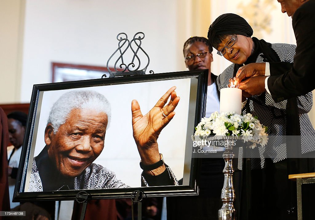 Winnie Madikizela-Mandela, the second wife of former South African president Nelson Mandela lights a candle for the former president during an interfaith prayer service for Former South African President Nelson Mandela at the Johannesburg City Hall on July 14, 2013 in Johannesburg, South Africa. Former President Nelson Mandela has been hospitalized at the Medi-Clinic Hospital in Pretoria since June 8 for treatment for a recurring lung infection.