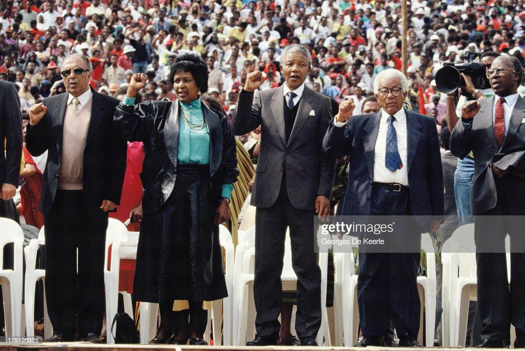 Winnie Mandela African National Congress leader Nelson Mandela and general secretary Walter Sisulu attend a rally in Soweto on February 13 1990 in...