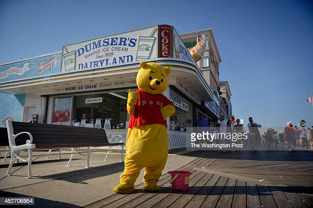 Winnie the Pooh makes an appearance on the boardwalk for tips in Ocean City Maryland on July 01 2014