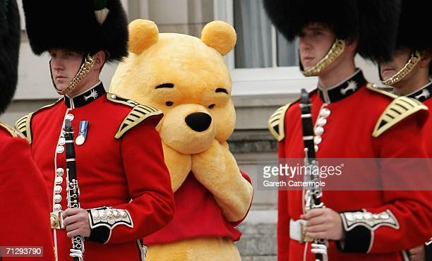 Winnie the pooh stands behind the guards on the Forecourt of Buckingham Palace for the Queen's 80th Birthday Children's Garden Party on June 25 2006...