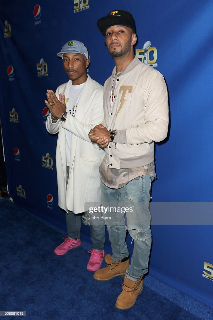 GRAMMY winning artist Pharrell (L) and Swizz Beatz arrive at Pepsi Super Friday Night at Pier 70 on February 5, 2016 in San Francisco, California.