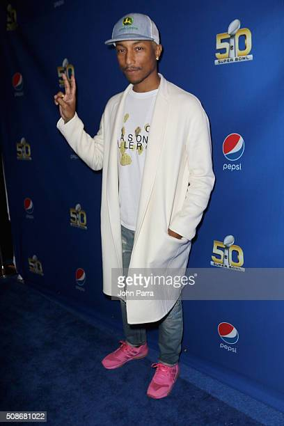 GRAMMY winning artist Pharrell arrives at Pepsi Super Friday Night at Pier 70 on February 5 2016 in San Francisco California