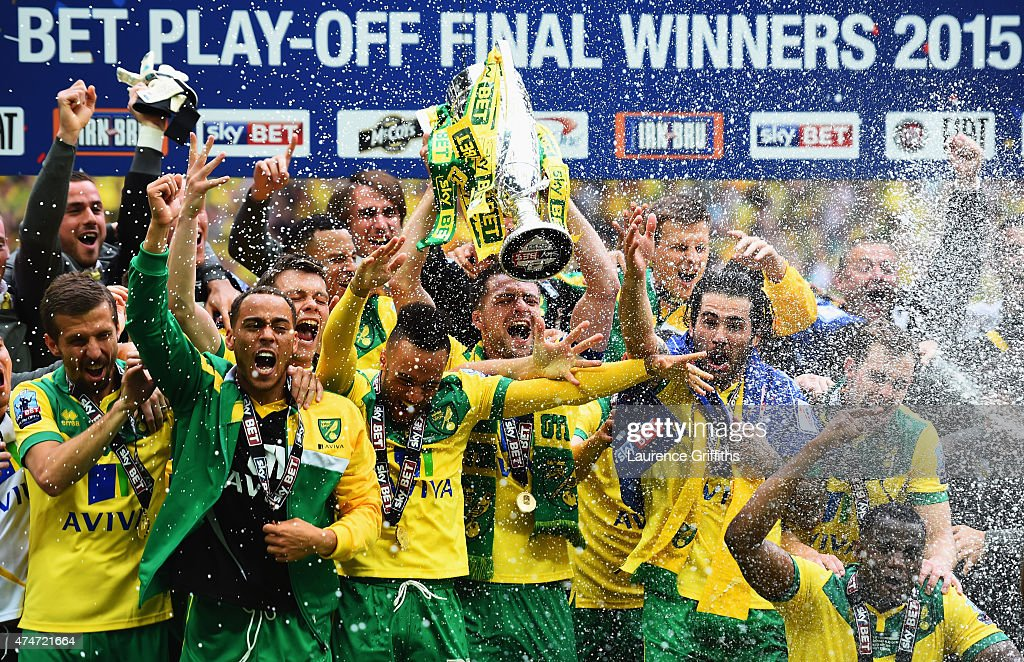 Winning captain Russell Martin of Norwich City celebrates with the trophy alongside team mates after the Sky Bet Championship Playoff Final between Middlesbrough and Norwich City at Wembley Stadium on May 25, 2015 in London, England. Norwich City seal promotion to the Premier League with a 2-0 victory
