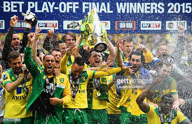 Winning captain Russell Martin of Norwich City celebrates with the trophy alongside team mates after the Sky Bet Championship Playoff Final between...