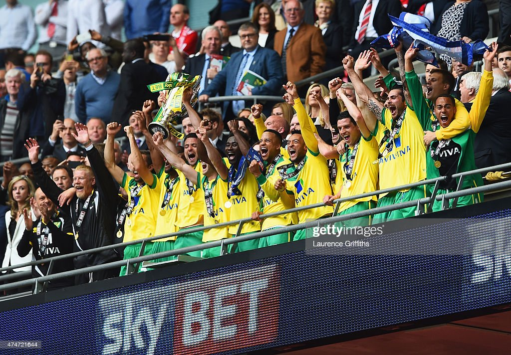 Winning captain Russell Martin of Norwich City lifts the trophy in celebration alongside team mates after the Sky Bet Championship Playoff Final between Middlesbrough and Norwich City at Wembley Stadium on May 25, 2015 in London, England. Norwich City seal promotion to the Premier League with a 2-0 victory