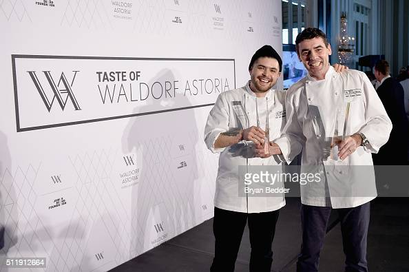 Winning chefs Erik BrunerYang and Benoit Chargy pose onstage during Taste of Waldorf Astoria at Waldorf Astoria Hotel on February 23 2016 in New York...