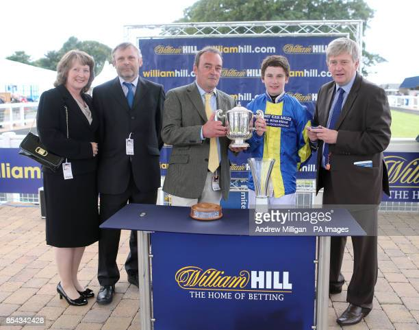 Winning connections of Levitate including jockey Oisin Murphy trainer JJ Quinn and owner Mr Charles Wentworth after winning the William Hill iPhone...