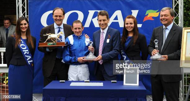 Winning connections of Mukhadram winner of The CoralEclipse including jockey Paul Hanagan and trainer William Haggas