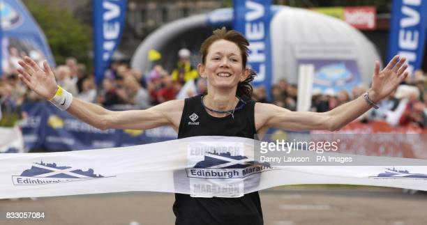 Winning female Fiona Matheson crosses the Edinburgh Marathon finish line with a time of 2 hours 54 minutes