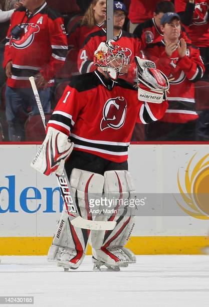 Winning goalie Johan Hedberg of the New Jersey Devils reacts after defeating the New York Islanders at the Prudential Center on April 3 2012 in...