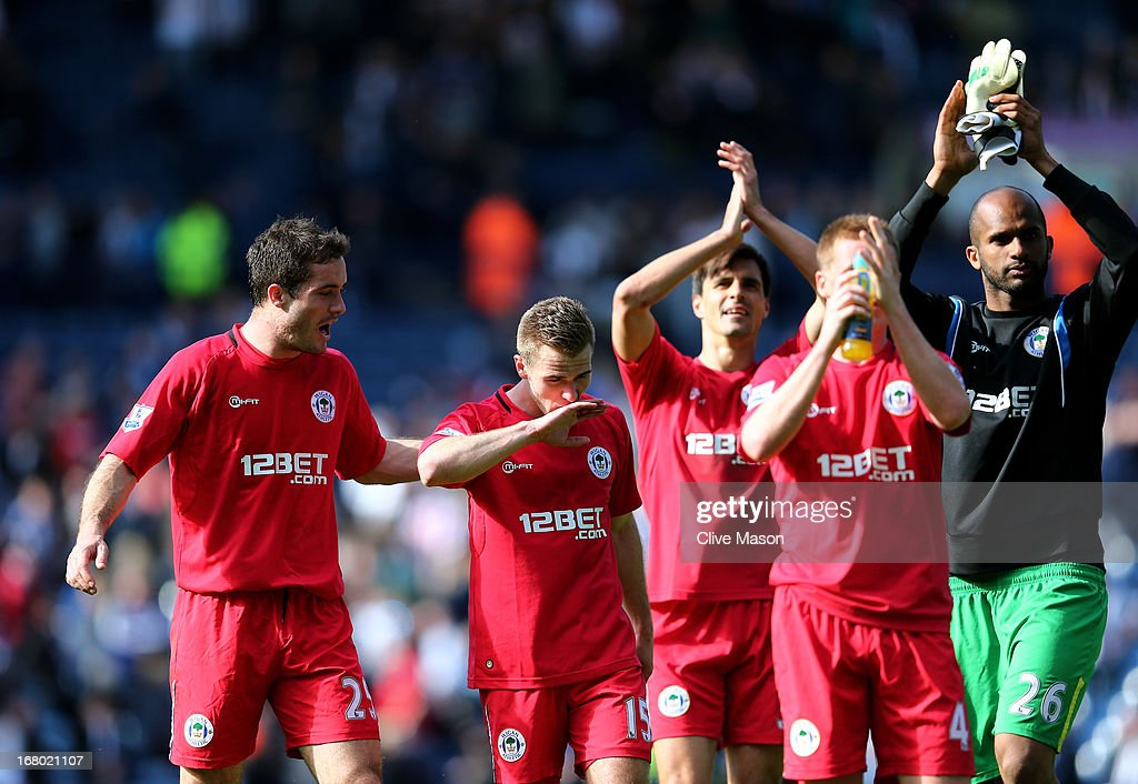 Winning goalscorer <a gi-track='captionPersonalityLinkClicked' href=/galleries/search?phrase=Callum+McManaman&family=editorial&specificpeople=5872412 ng-click='$event.stopPropagation()'>Callum McManaman</a> #15 of Wigan and teammates celebrate their 3-2 victory during the Barclays Premier League match between West Bromwich Albion and Wigan Athletic at The Hawthorns on May 4, 2013 in West Bromwich, England.
