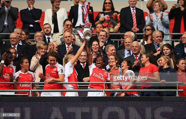 Winning goalscorer Danielle Carter of Arsenal lifts the trophy with team mates after the SSE Women's FA Cup Final between Arsenal Ladies and Chelsea...
