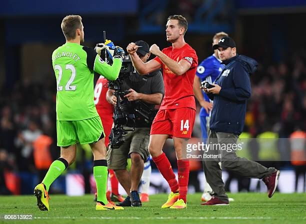 Winning goalscorer Jordan Henderson of Liverpool celebrates victory with Simon Mignolet after the Premier League match between Chelsea and Liverpool...