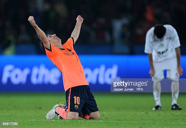 Winning goalscorer Lionel Messi of FC Barcelona celebrates at the end of the FIFA Club World Cup Final match between Estudiantes LP and FC Barcelona...