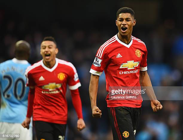 Winning goalscorer Marcus Rashford of Manchester United and team mate Jesse Lingard celebrate victory after the Barclays Premier League match between...