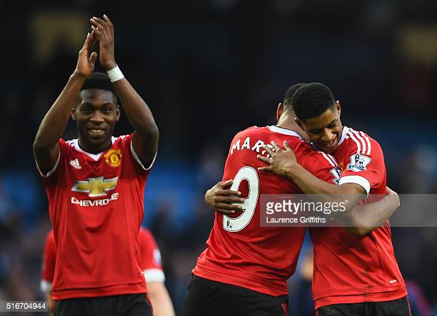 Winning goalscorer Marcus Rashford of Manchester United and team mates Anthony Martial and Timothy FosuMensah celebrate victory after the Barclays...