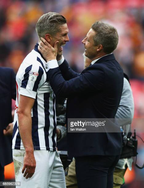 Winning goalscorer Steve Morison of Millwall celebrates victory and promotion with Neil Harris manager of Millwall after the Sky Bet League One...
