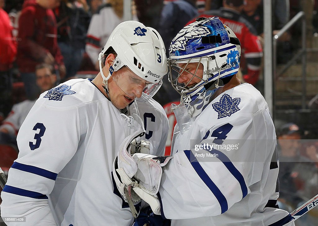Winning goaltender and number one star of the game goaltender James Reimer #34 of the Toronto Maple Leafs is congratulated by Dion Phaneuf #3 after defeating the New Jersey Devils at the Prudential Center on April 6, 2013 in Newark, New Jersey. The Leafs defeated the Devils 2-1.