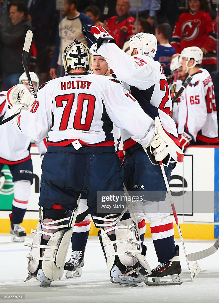 Winning goaltender Brayden Holtby #70 of the Washington Capitals is congratulated after defeating the New Jersey Devils at the Prudential Center on February 6, 2016 in Newark, New Jersey. The Capitals defeated the Devils 3-2.