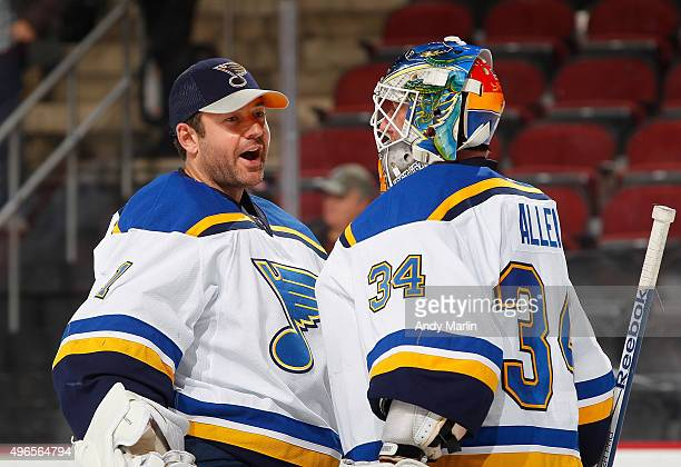 Winning goaltender Jake Allen of the St Louis Blues is congratulated by backup goaltender Brian Elliott after shutting out the New Jersey Devils at...