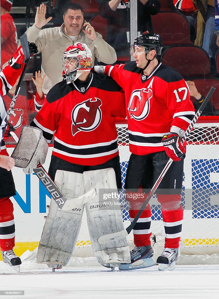 Winning goaltender Johan Hedberg #1 of the New Jersey Devils is congratulated by Ilya Kovalchuk #17 after defeating the Philadelphia Flyers 5-2 at the Prudential Center on March 13, 2013 in Newark, New Jersey.