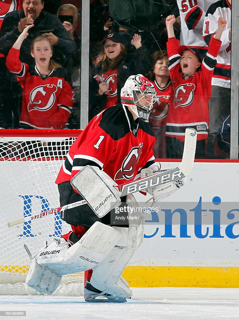 Winning goaltender <a gi-track='captionPersonalityLinkClicked' href=/galleries/search?phrase=Johan+Hedberg&family=editorial&specificpeople=202078 ng-click='$event.stopPropagation()'>Johan Hedberg</a> #1 of the New Jersey Devils reacts after defeating the Winnipeg Jets in a shootout at the Prudential Center on March 10, 2013 in Newark, New Jersey. The Devils defeated the Jets 3-2 in a shootout.
