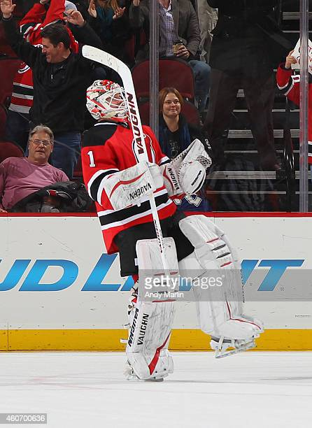 Winning goaltender Keith Kinkaid of the New Jersey Devils reacts after recording his first NHL victory defeating the Tampa Bay Lightning in a...