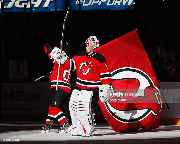 Winning goaltender Keith Kinkaid of the New Jersey Devils salutes the crowd after being named the number one star of the game after the Devils...