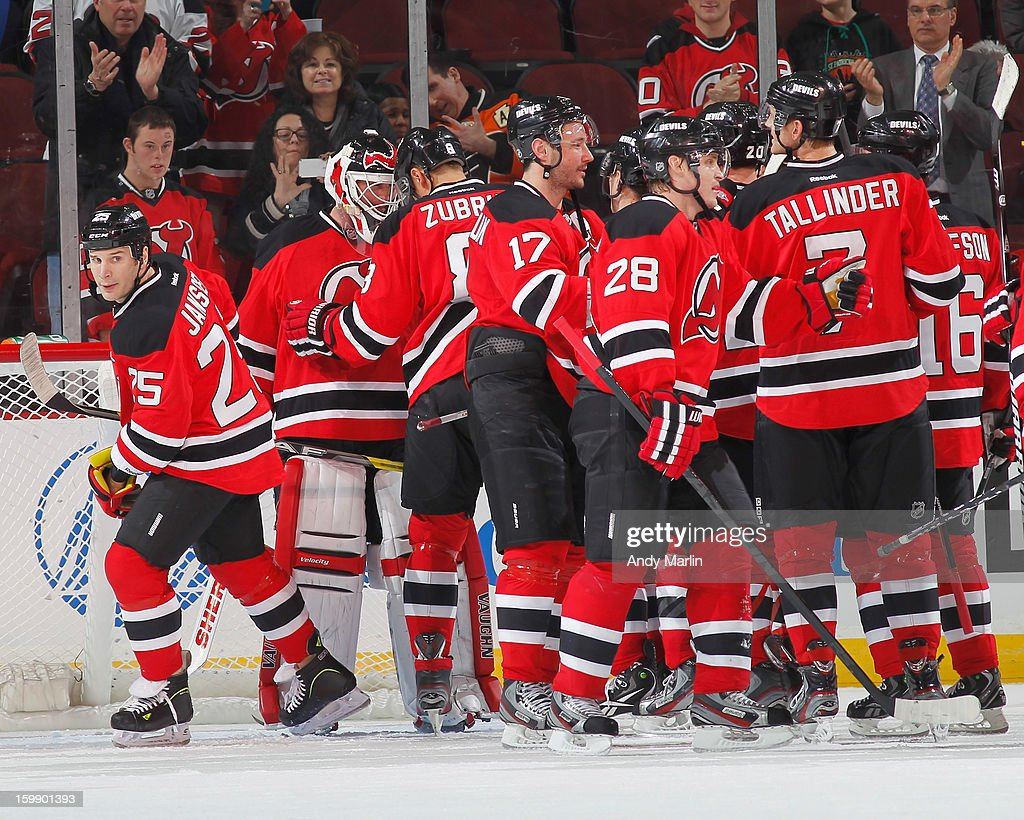 Winning goaltender Martin Brodeur #30 of the New Jersey Devils is congratulated by his teammates after shutting out the Philadelphia Flyers during the Devils' home opener at the Prudential Center on January 22, 2013 in Newark, New Jersey. The Devils defeated the Flyers 3-0.