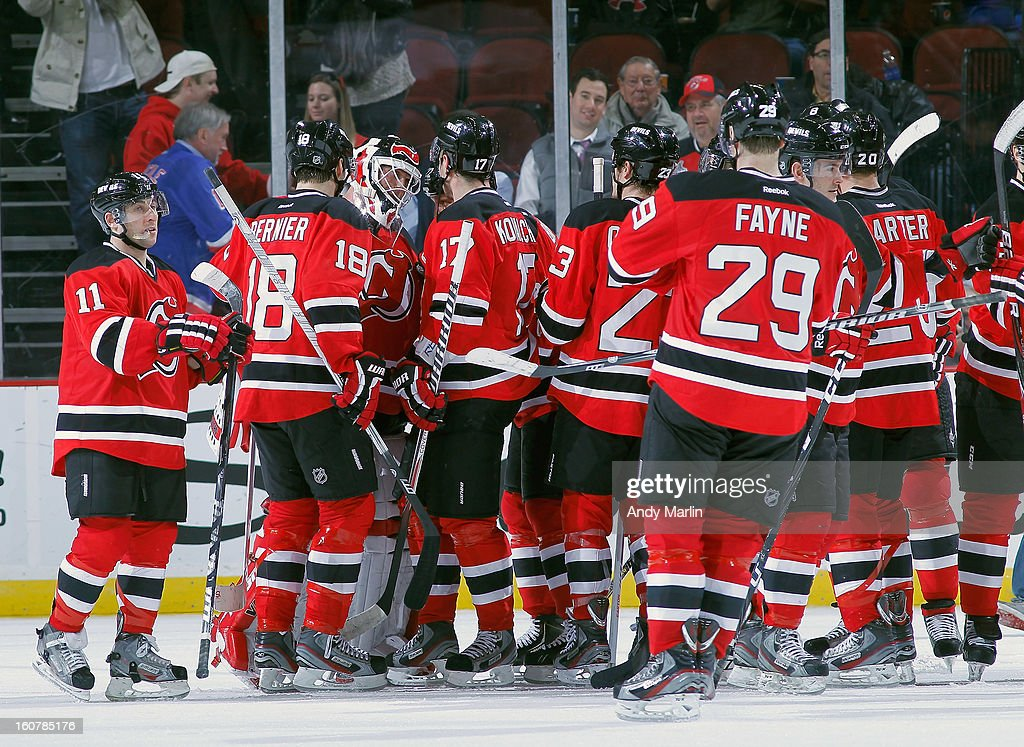 Winning goaltender <a gi-track='captionPersonalityLinkClicked' href=/galleries/search?phrase=Martin+Brodeur&family=editorial&specificpeople=201594 ng-click='$event.stopPropagation()'>Martin Brodeur</a> #30 of the New Jersey Devils is congratulated by his teammates after defeating the New York Rangers at the Prudential Center on February 5, 2013 in Newark, New Jersey. The Devils defeated the Rangers 3-1.