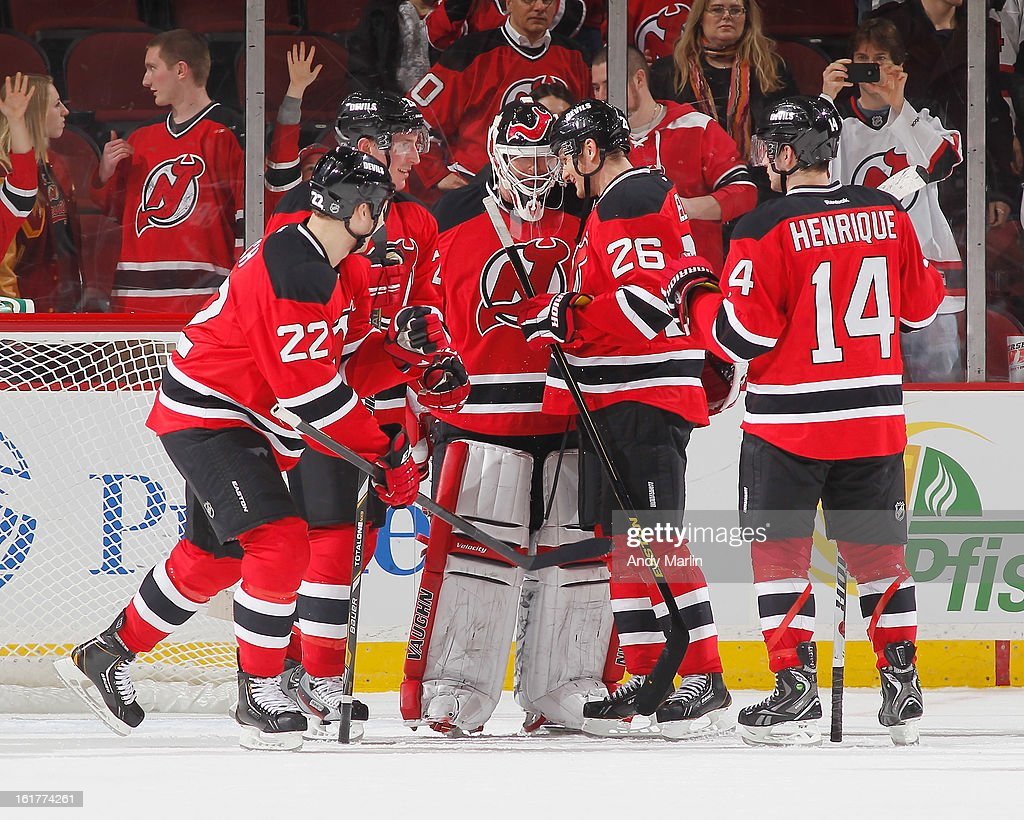 Winning goaltender Martin Brodeur #30 of the New Jersey Devils is congratulated by his teammates after defeating the Philadelphia Flyers at the Prudential Center on February 15, 2013 in Newark, New Jersey. The Devilds defeated the Flyers 5-3.