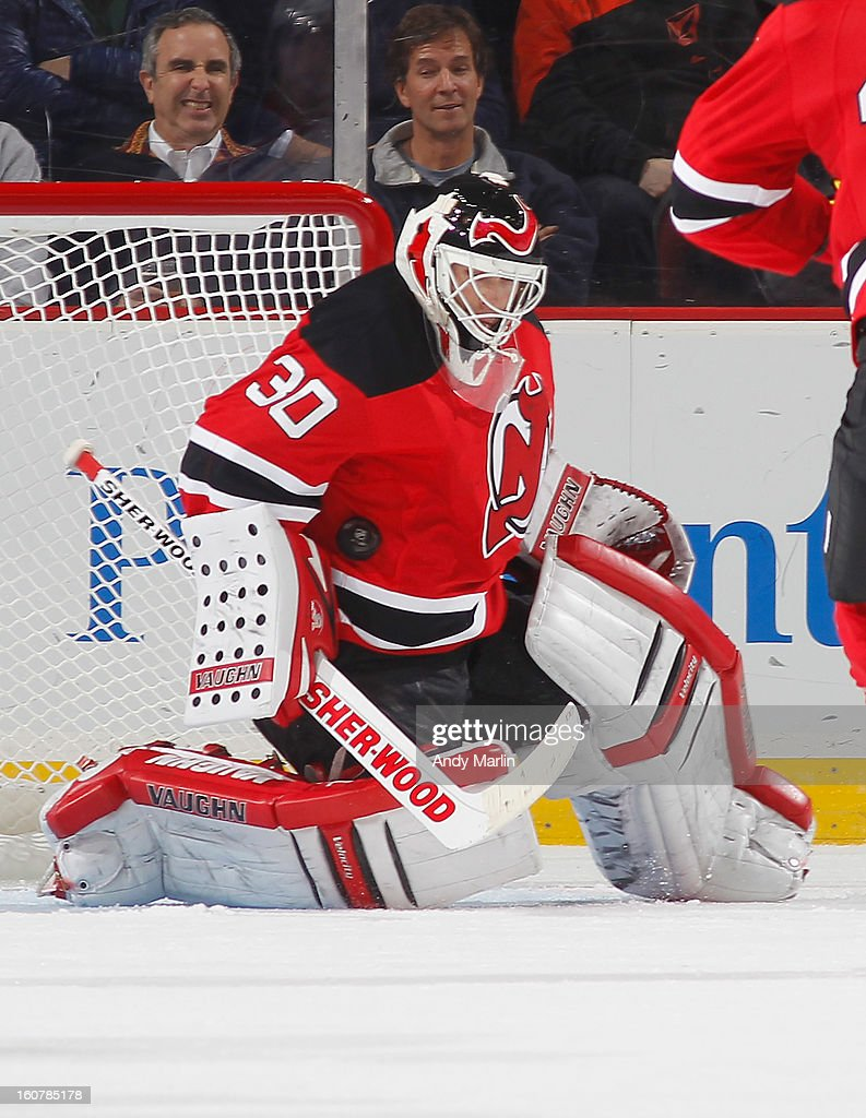 Winning goaltender <a gi-track='captionPersonalityLinkClicked' href=/galleries/search?phrase=Martin+Brodeur&family=editorial&specificpeople=201594 ng-click='$event.stopPropagation()'>Martin Brodeur</a> #30 of the New Jersey Devils makes a save against the New York Rangers at the Prudential Center on February 5, 2013 in Newark, New Jersey. The Devils defeated the Rangers 3-1.