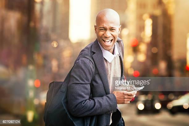 Winning happy black man urban portrait with phone