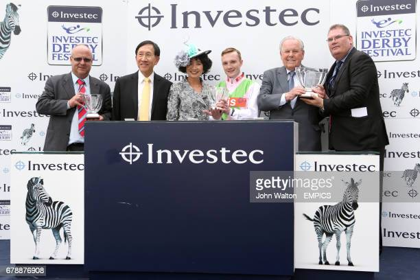 Winning jockey Frederik Tylicki and trainer Richard Fahey during the presentation for the Investec Asset Management Handicap won by Heaven's Guest