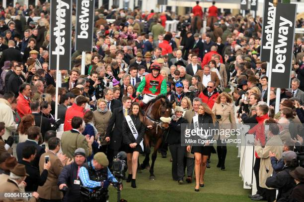 Winning jockey Sam TwistonDavies celebrates on Dodging Bullets after victory in the Betway Queen Mother Champion Chase
