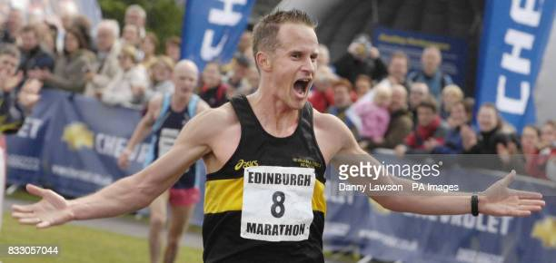 Winning male Ian Grime crosses the Edinburgh Marathon finish line with a time of 2 hours 32 minutes