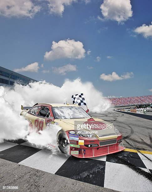 Winning Nascar driver doing a burnout.