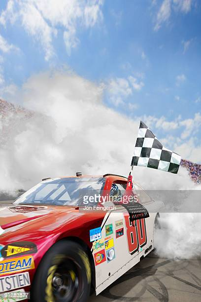 Winning Nascar driver doing a burnout.