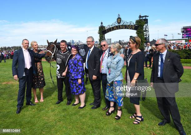 Winning owners pose after Winx won Race 5 Turnbull Stakes during Turnbull Stakes day at Flemington Racecourse on October 7 2017 in Melbourne Australia