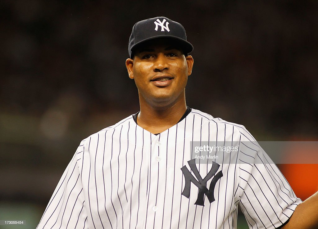 Winning pitcher <a gi-track='captionPersonalityLinkClicked' href=/galleries/search?phrase=Ivan+Nova&family=editorial&specificpeople=5743486 ng-click='$event.stopPropagation()'>Ivan Nova</a> #47 of the New York Yankees smiles after pitching a complete game against the Baltimore Orioles at Yankee Stadium on July 5, 2013 in the Bronx borough of New York City. The Yankees defeated the Orioles 3-2.